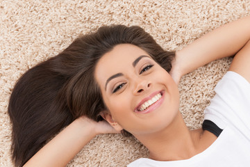 Women lying on the floor. Top view of cheerful young women lying