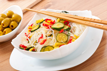 Rice noodles and vegetables on white plate