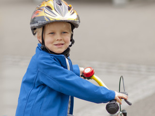 4 year old boy riding bicycle