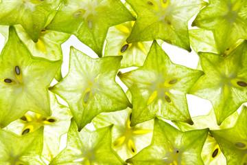 Slices of fruit star on white