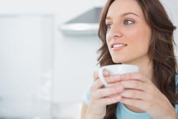Pretty brunette drinking coffee