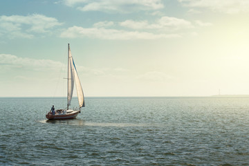 Sailing boat at the open sea with copy space