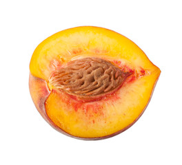 slice of peach with stone isolated on a white background
