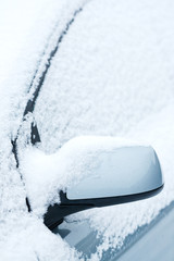 Detail of a car under snow