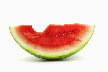 a slice of watermelon with a bite