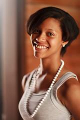 Happy African American teenage girl smiling