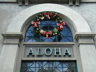 The Word Aloha and Christmas Wreath on side of Aloha Tower