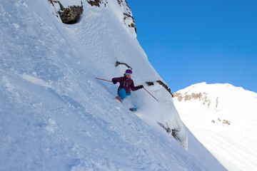 Woman Snow Skiing on Steep Slope with Mountain View