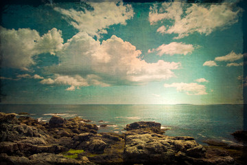 Ocean and rocky coast in retro grunge style