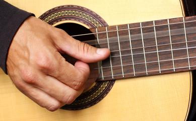 human hand playing guitar