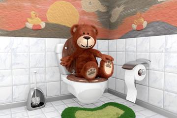süsser kuscheliger Teddybär auf Kloschüssel