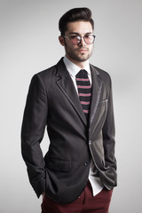 sexy man dressed elegant with s sock tie looking serious