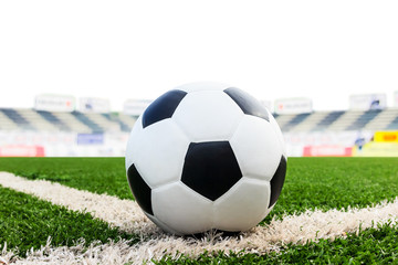 soccer ball on green grass field isolated