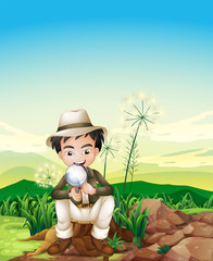 A boy sitting above a stump holding a magnifying lens