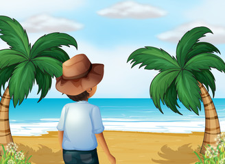 A boy with a hat at the beach