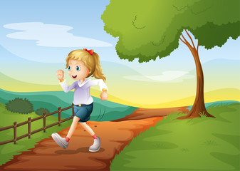 A young woman running in the hill