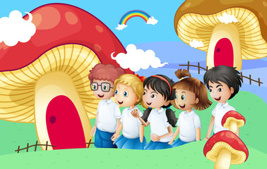 Five students near the giant mushroom houses