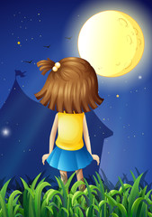 A little girl facing the bright fullmoon