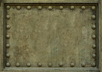 Background Texture Of Heavy Protective Metal Plate With Rivets