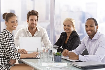 Happy businesspeople at a meeting