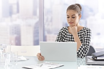 Young businesswoman with laptop computer