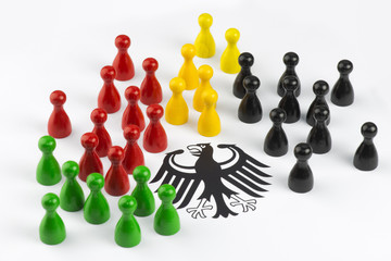 Political concept: Game figures with german federal eagle