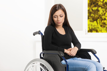 Women with disability. Depressed young women sitting at the whee