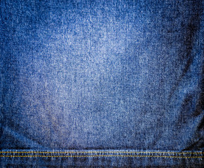 Abstract background.Blue striped jeans with sewing a seam.For te