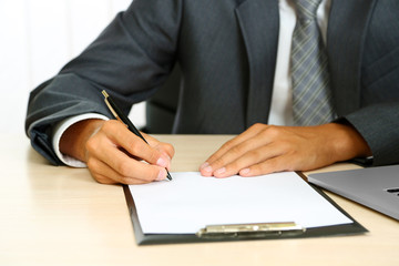 Closeup of businessman hands with clipboard