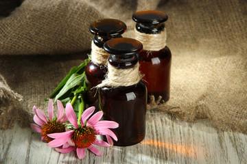 Medicine bottles with purple echinacea flowers