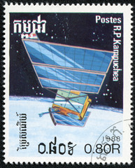 stamp printed in Cambodia, shows space-station and planet