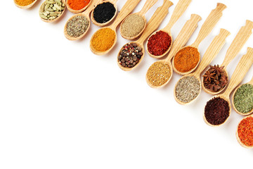 Wall Murals Herbs 2 Assortment of spices in wooden spoons, isolated on white