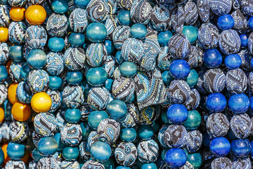 Beads made of wood and covered with fabric