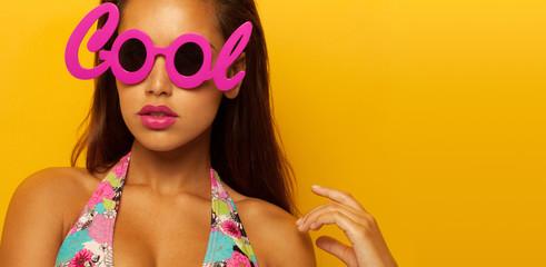Portrait of a stylish girl wearing cool glasses