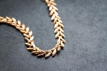 Gold chain. Shallow depth of field. Selective focus.