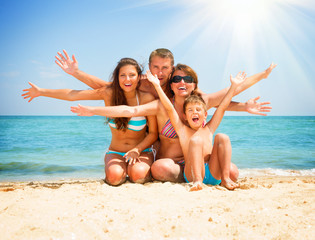 Wall Mural - Happy Family Having Fun at the Beach. Vacation concept
