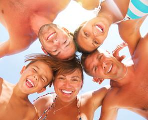 Wall Mural - Happy Laughing Big Family Having Fun at the Beach