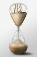 Hourglass with Tea Time made of sand. Concept of rest