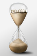 Hourglass with Promotion made of sand. Business concept