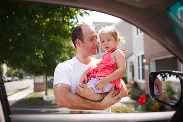Father with daughter through car window