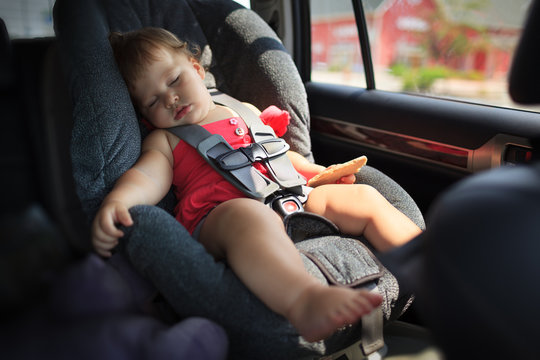 Child sleeping in car seat