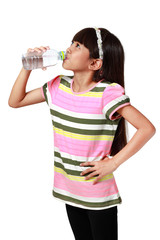 Little asian girl drinking water