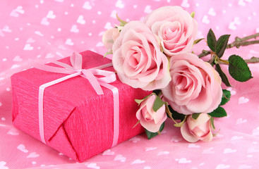 Romantic parcel on pink cloth background