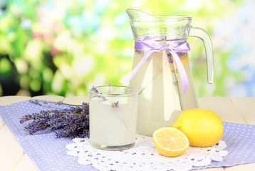 Lavender lemonade in glass jug and cocktail glasses,