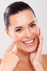 woman touching healthy face skin