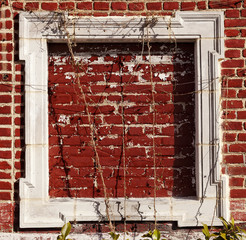 Empty Wooden Frame on Red Bricks Wall