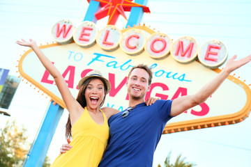Wall Mural - Las vegas people - couple happy cheering by sign