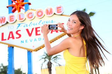 Wall Mural - Las Vegas Sign tourist woman happy taking photo