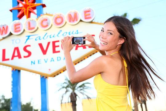 Las Vegas Sign tourist woman happy taking photo