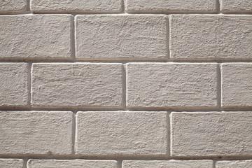 Gray stone wall with decorative bricks